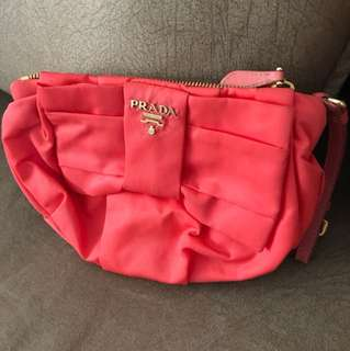 100% Authentic Prada Wristlet in coral color. Used condition 7/10. Not for fussy buyer.