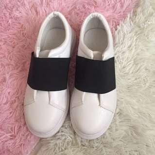 White platform slip on shoes