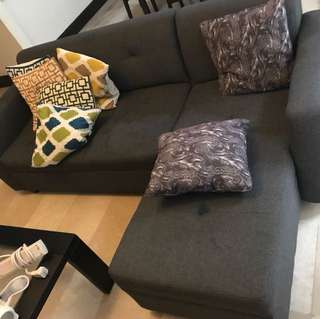 L shaped sofa w/ pillows