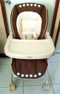 Aprica manual swing high chair