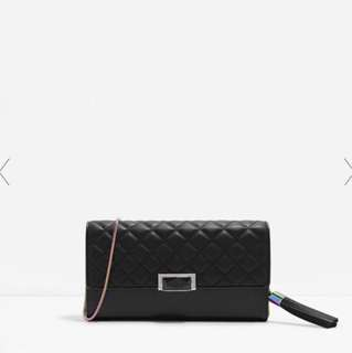 Quilted Tasselled Clutch