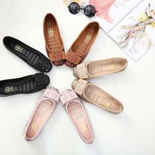 Sepatu *Tory Burch*