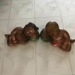 Antique wooden sleeping boy and girl