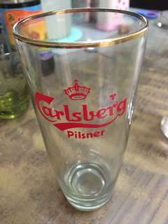 Old beer glass with gold ring