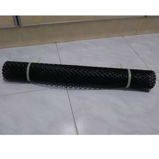 unused portion of black PVC mesh fencing - width 50cm