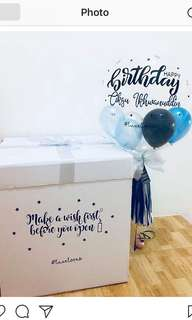 Surprise box with balloons