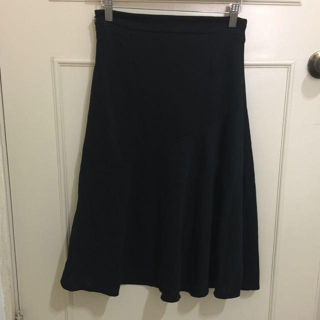 裙擺搖搖及膝淑女黑裙