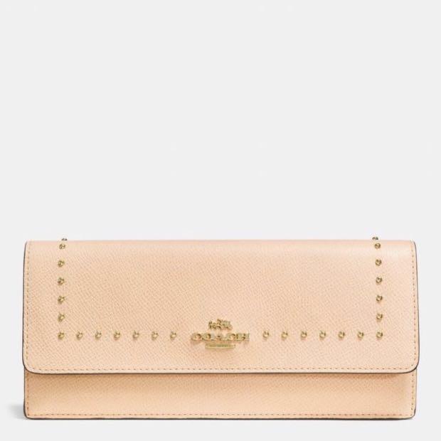 Coach peach pink stud long wallet
