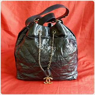 CHANEL DRAWSTRING BUCKET QUILTED CHAIN LAMB BAG