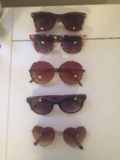 assorted sunglasses 1 for 10 or 2 for 15. all for 25.