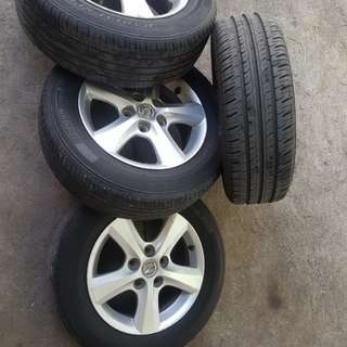 SALE ALERT!!! REPRICED.   Mazda 3 195/65 R15 Stock Mags Call me @ 09178502921
