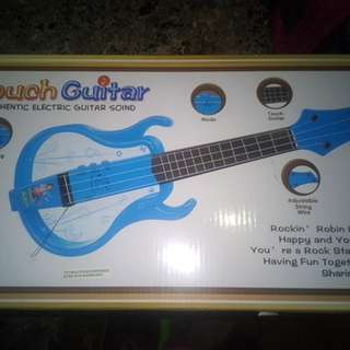 Touch guitar battery operated