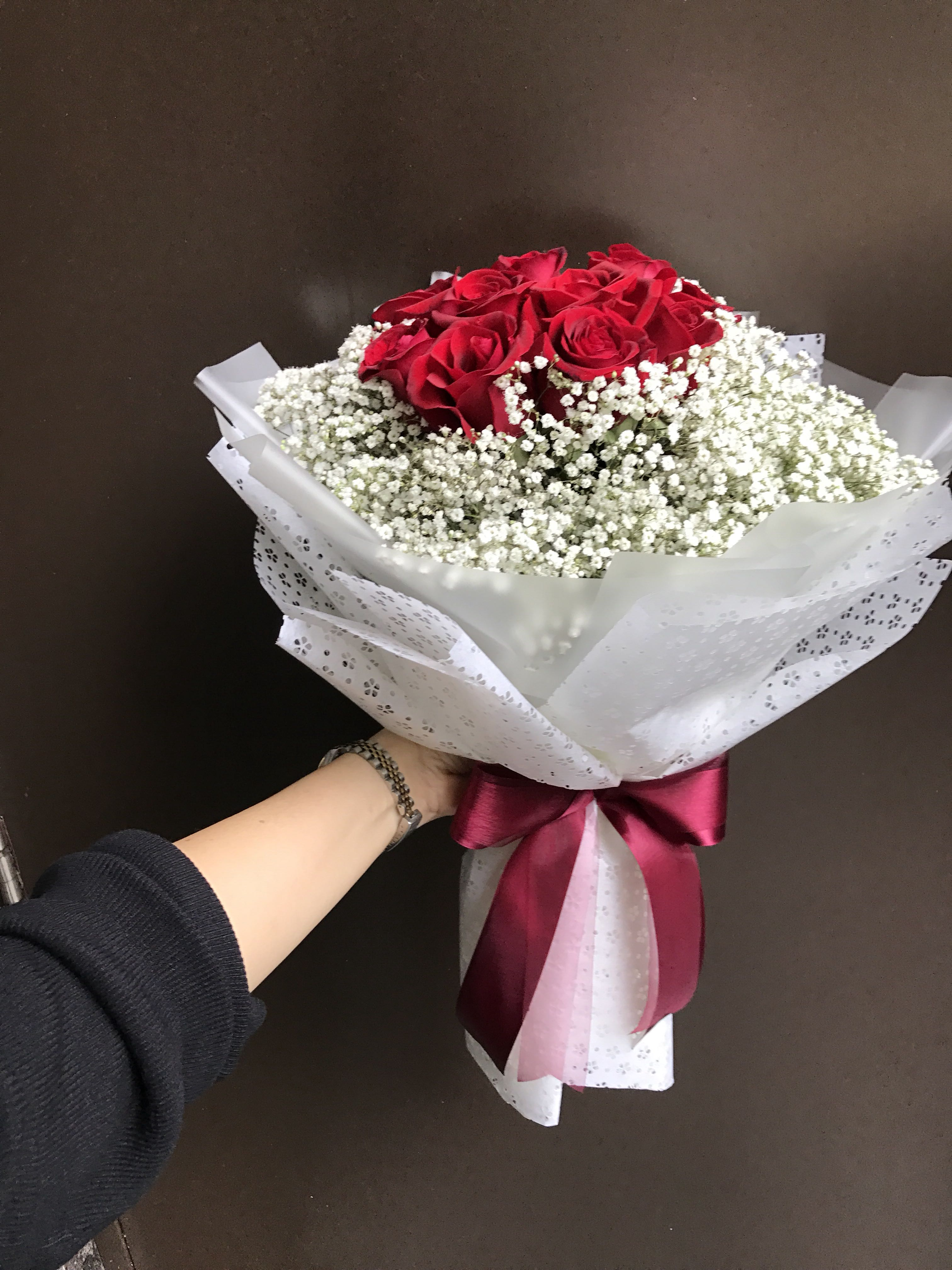 12 red roses with white Baby Breath Bouquet