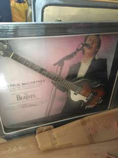 A bass guitar signed by Paul McCartney