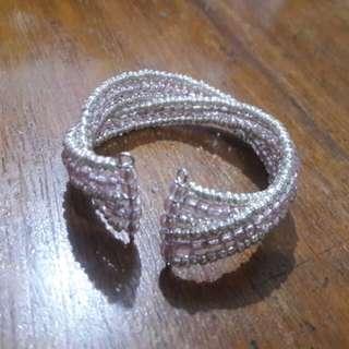 Silver and pinkish beads bangle bracelet