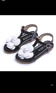 Black sandals with Chanel flower