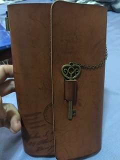 Planner with key charm