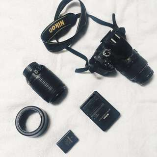 Nikon D5100 with free 200mm lens