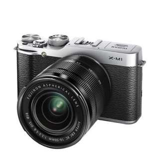 Fujifilm X-M1 with 16-50mm & half leather case