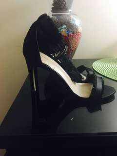 Black heels worn only once... they are too small for me! I am size 7 and these are size 6