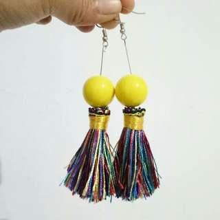 Yellow bomb tassel earrings