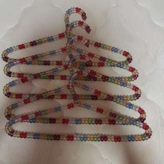 Multi coloured beaded design hangers