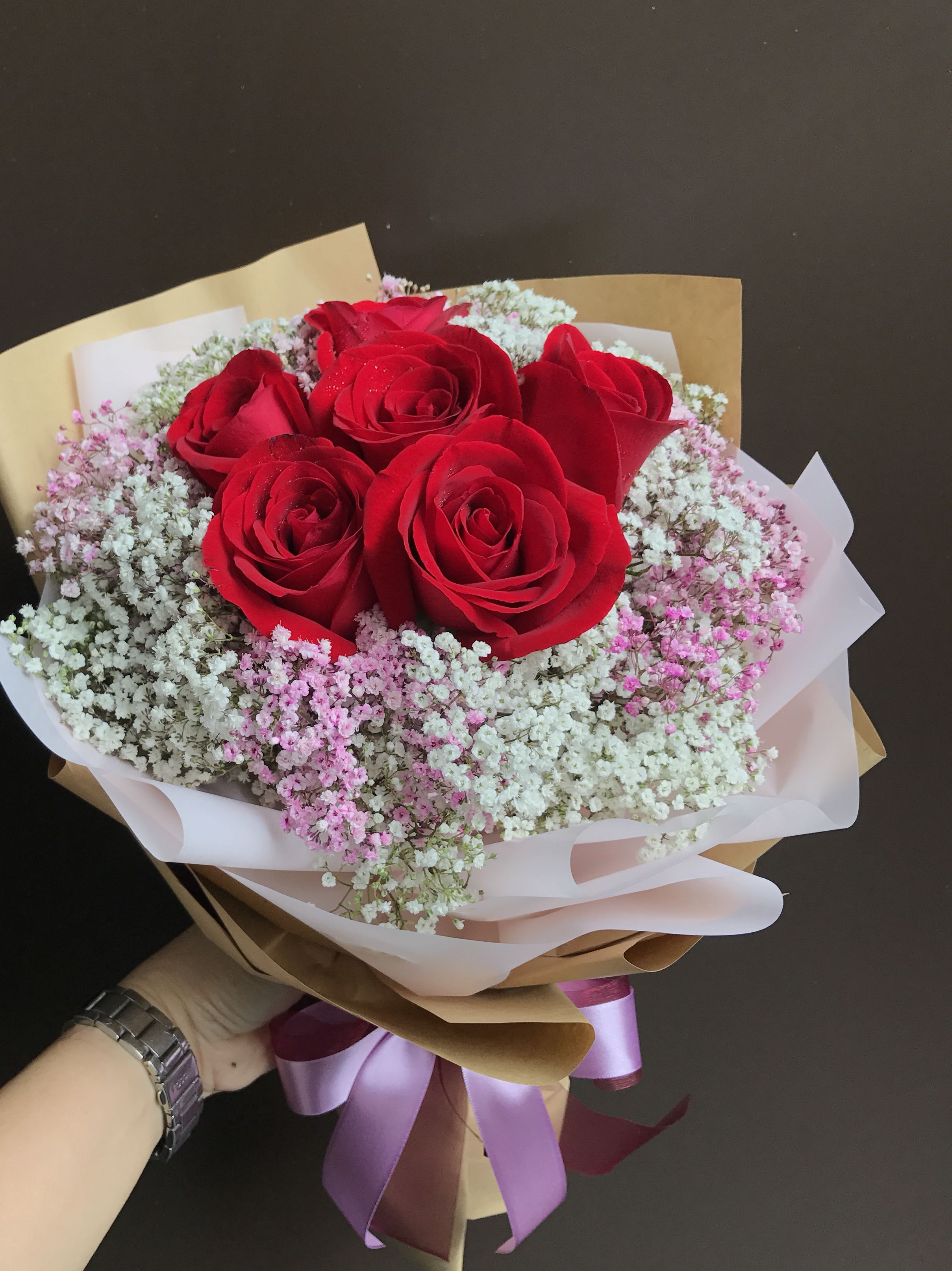 6 red roses with pink & white Baby Breath Bouquet