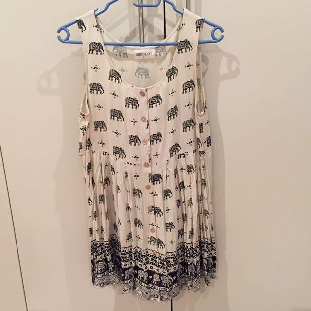 Cream dress with elephant detail