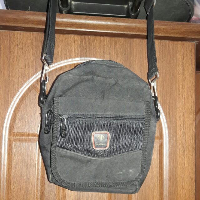 Mini sling bag tracker