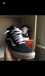 Black and white vans mid