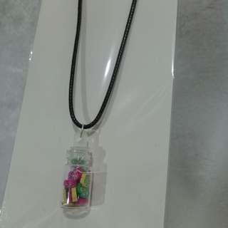 Flowers in bottle necklace