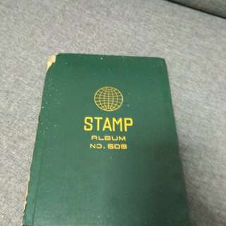 Stamp album with 450 collectable stamps