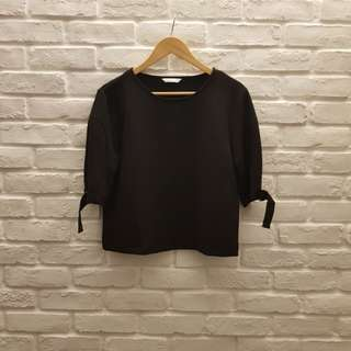 Shift top in black with buckles at sleeves