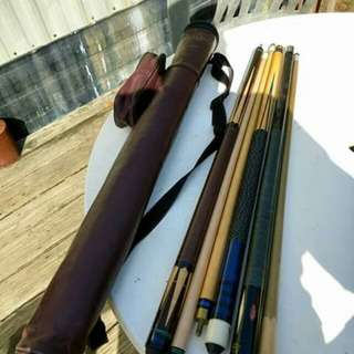 Pool cues with leather bag