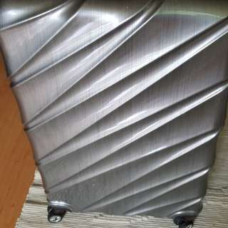"""Greyish silver 29"""" luggage with 4 wheeler, 360 deg ( used once only)"""