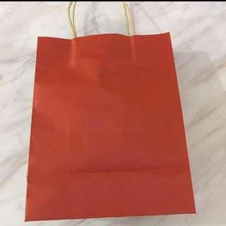 Red color goodie bag paper bag