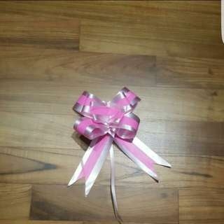Brand New ready made ribbon. 1pack blue and 1 pack pink. Each pack 10 pc. 1.50 for 1 pack. 2.50 for 2 packs.
