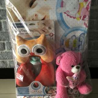 Lucky Baby package with a baby bouncer, travel pillow and soft toy