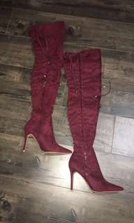 Knee high laced heel boots