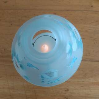 Battery operated lamp with shade.