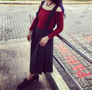 Black pinafore knee length skirt