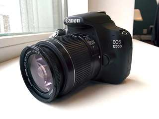 Canon EOS 1200D Digital SLR Camera with EF-S 18-55mm f/3.5-5.6 III Len with Bag and Tripod.