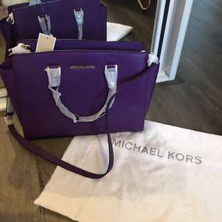 A BRAND NEW michael kors selma large IN purple color