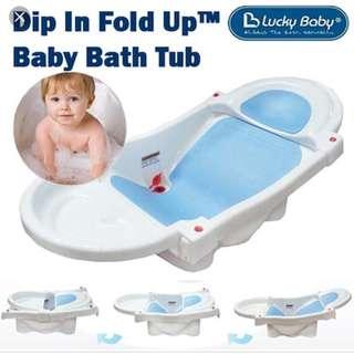 Lucky baby dip in bathtub