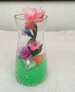 Nylon stocking flowers in a glass jar