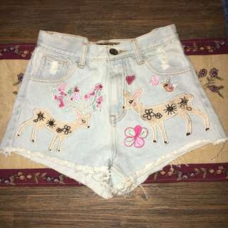 Embroidered pastel denim shorts