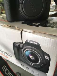 Canon 1300D with 15-88mm