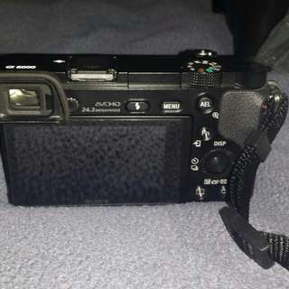 Sonya6000 with 4 lences adaptors and 2 batterys and charger
