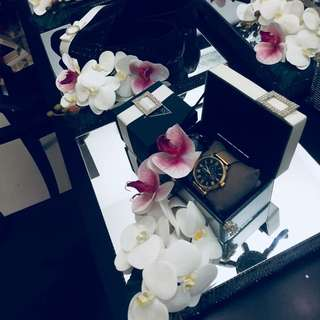 watch gift set on mirror tray with orchids