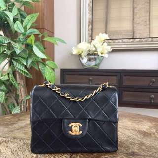 Authentic Chanel vintage quilted mini flap bag lambskin in black